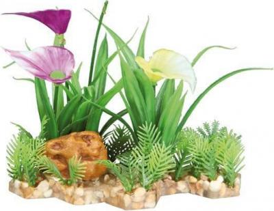 Plante plastique sur lit de graviers